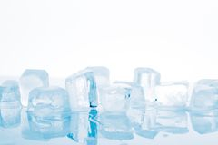 Ice cubes on a white background Stock Image