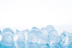 Ice cubes on a white background Royalty Free Stock Images
