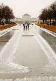 Ice curling at Nymphenburg palace. Frozen canal used to create lanes for curling competitions at Nymphenburg palace in Munich, Germany Royalty Free Stock Images