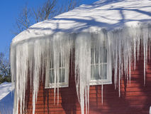 Ice dams and snow on roof and gutters Royalty Free Stock Images
