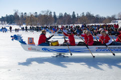 Ice Dragon Boat Race. OTTAWA - FEB 18: Ice dragon boat racing held in North America for the first time in Ottawa, Canada on February 18, 2017 on Dow`s Lake Stock Image
