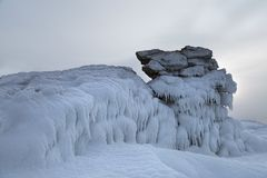 Ice dragon from frozen rock. In fog, fantastic winter landscape stock photos