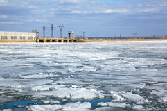 Ice drift and hydropower station Stock Images