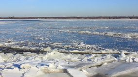 Ice drift on a large river, current breaks ice. Ice drift on the big river, the sound of breaking ice stock video