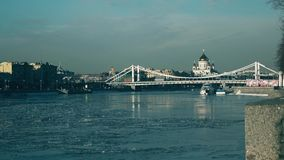 Ice drift on Moscow river, Krymsky bridge and the main Russian Cathedral of Christ the Savior. 4K shot stock video