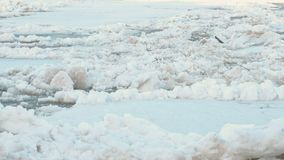 Ice drift on the river. Moving big ice floes close up. stock footage