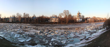 Ice drift on the river in Russia, the church on the shore, the i Stock Image