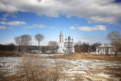 Ice drift on the river in Russia, the church on the shore, the i Stock Images