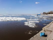 Ice drift on the river in spring. Embankment in the city of Saratov. Sunny day in April Royalty Free Stock Image