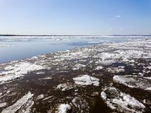 Ice drift on the river in spring. Embankment in the city of Saratov. Sunny day in April Royalty Free Stock Photography