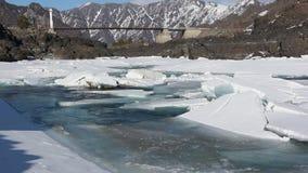Ice drift on the turquoise Katun River in the spring near Oroktoysky Bridge, Altai. Russia stock video