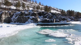 Ice drift on the turquoise river in the spring, Katun River, Altai. Russia stock video