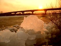 Ice drift on the Ussuri River. An ice drift on the Ussuri River in the late afternoon sunset in the Russian Far East. In the distance, you can see an automobile Royalty Free Stock Photo