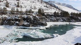 Ice drifting on the turquoise river in the spring,  Altai, Russia. Ice drifting on the turquoise river in the spring, Katun River, Altai, Russia stock video footage