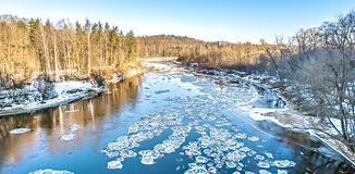 Ice drifting in wintry river Royalty Free Stock Image