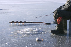 Ice drill and ice fishing rod Royalty Free Stock Image