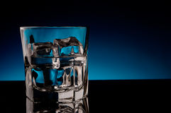 Ice and a drink in a glass Stock Photos