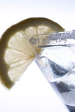Ice drink with lemon. Ice drink, sugar coated glass and lemon slice Royalty Free Stock Photo