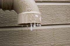 Ice drop on drain pipe stock photography