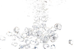 Ice drop into Water Royalty Free Stock Images