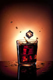 Ice dropped in beverage. Royalty Free Stock Images