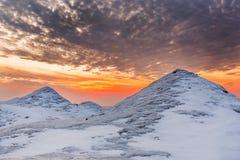 Ice Dunes on a Lake Huron Shoreline at Sunset Royalty Free Stock Image