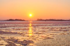 The golden hour. Ice on the Elbe at sunset in early spring.Golden hour Royalty Free Stock Images