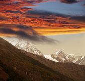 Ice fall in snow mountains, sunset stock photos