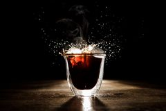 The ice falling into coffee Royalty Free Stock Images