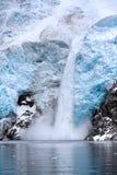Ice Falling from Glacier in Alaska stock photos