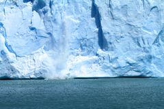 Melting Glacier. Ice falling off of a glacier in Patagonia, South America Royalty Free Stock Photography