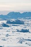 Ice field in Greenland. Sunset on Sermilik fjord's ice field in Greenland Stock Photos