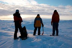 Ice field in Greenland. People contemplating sunset on Sermilik Fjord's ice field, Greenland royalty free stock photo