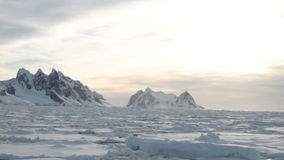 Ice field at Lemaire Channel, sunset stock footage