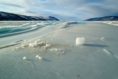 Ice fields. The fishing hole in the ice and extracted from the wells of a pillar of ice Royalty Free Stock Photo