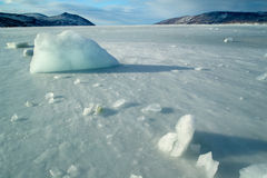 Ice fields. The fishing hole in the ice and extracted from the wells of a pillar of ice Stock Photos