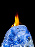 Ice and fire isolated. On black stock photography