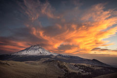 Between Ice and Fire. Sunset over Popocatepetl volcano, view from Iztaccihuatl volcano Royalty Free Stock Photos