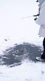 Ice Fisherman. Man is ice fishing on the lake Stock Photography