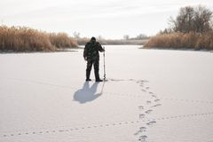 Ice fisherman on winter lake Stock Image