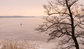 Ice fishermen enjoying winter Royalty Free Stock Images
