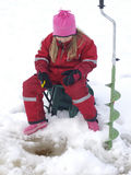 Ice fishing. Little girl is ice fishing on a lake Stock Photography