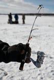Ice fishing. Winter on the lake. Ice fishing Stock Photos