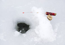 Ice Fishing. Fishing line in a ice hole Royalty Free Stock Photos