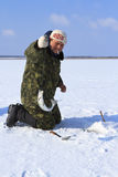 Ice Fishing. The fisherman gets fish royalty free stock photo