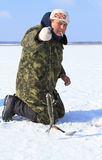 Ice Fishing. The fisherman gets fish royalty free stock photos
