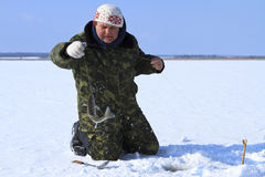Ice Fishing. A fisherman caught a fish stock image