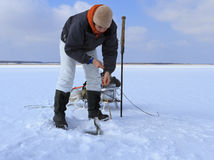 Ice Fishing. Female Fisher fishing royalty free stock photography