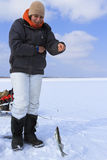 Ice Fishing. Winter fishing. Fishing for fish from the hole stock image