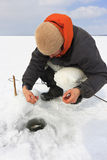 Ice Fishing. Winter fishing. Fishing for fish from the hole royalty free stock images